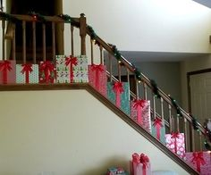 """Presents"" Christmas Staircase Decorations @Rachelle Milasauskas  this would be cute in your foyer"