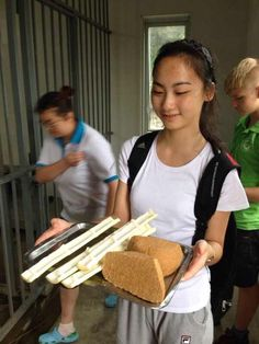 Volunteering at China Conservation and Research Center for Giant Pandas. In this picture, I'm preparing to feed the pandas with panda buns I made and fresh bamboos. :)