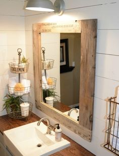 frame your old mirror with a frame made from old wood pallets