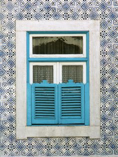 This is why Portugal is probably the world capital of tiles, Lisbon… Wooden Shutters, Small Shutters, Sintra Portugal, Shutter Doors, Portuguese Tiles, Unique Doors, Through The Window, Painted Doors, Door Knockers
