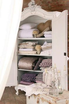 French Armoire. Also love the colors of the linens and bedding inside.