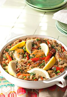 Quinoa Paella- Anything rice can do, quinoa can do. Try it in this paella with smoky ham and juicy pieces of chicken.