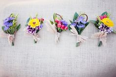 Mismatched bright boutonnieres lauralesliephotography.com