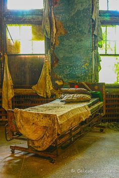 Abandoned Mental Asylum Bed at Pennhurst State School & Hospital in Spring City, Pennsylvania.