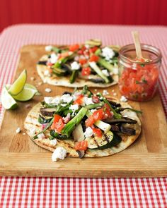 Grilled-Vegetable Tostadas  Grill zucchini, portobello mushrooms, and scallions to top these colorful tostadas. Brush flour tortillas with olive oil and brown them on the grill before topping with the grilled vegetables, feta cheese, and fresh salsa.