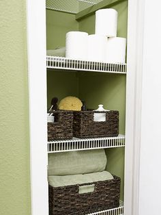 Storage Central - they even used the baskets I LOVE!! To make up for the lack of storage throughout the bathroom, Kate made the most of the room's narrow closet. Baskets and bins eliminate clutter and keep essential items within reach. Painting the closet frame white connects the wire shelving to the rest of the room and makes the green walls pop.