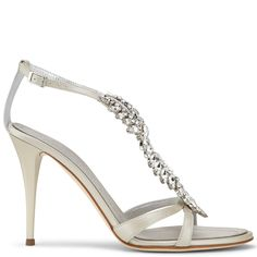 GIUSEPPE ZANOTTI Ice white nappa leather sandals with a 110mm (4.3 inch) heel and a beautifully sparkling crystal accessory. These shoes bring simplicity, design and style to unforgettable moments.