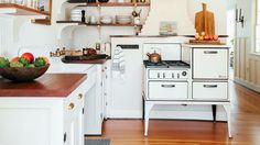 Bring in the Old (and Old-Looking) This kitchen incorporates a vintage-style stove and farm sink to evoke a farmhouse vibe. New native-fir open shelves and countertops were added as a rustic contrast to the otherwise white palette. Beach Cottage Decor, Coastal Cottage, Lakeside Cottage, Cottage Ideas, Coastal Living, Beautiful Kitchen Designs, Beautiful Kitchens, Decoration Ikea, Built In Bunks