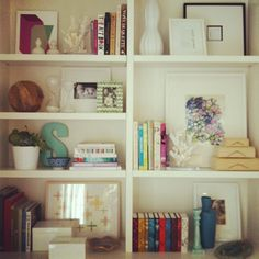 these bookshelves are decorated really nicely.