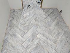 Dapple grey wood look herringbone tile
