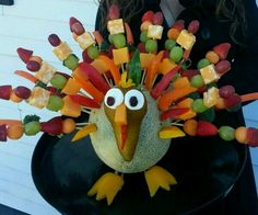 Turkey made out of fruit and cantaloupe body