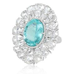 Sutra ring set with a Paraiba tourmaline and rose-cut diamonds, encircled by a diamond halo, in white gold.