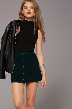 A mini skirt crafted from corduroy featuring a burnished button-down front.