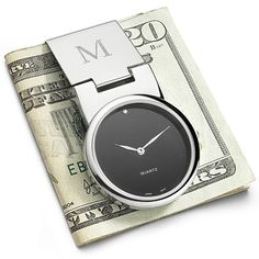 Money clips to keep his money  http://www.topteny.com/top-10-dazzling-christmas-gifts-for-men/