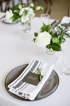 Rustic napkins and simple green and white centerpieces | Photography: Mint Photography