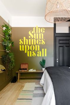 Ivie's Moody Boho Bedroom makeover Reveal complete with a lettered wall, DIY headboard, houseplants and Shermin Williams Verde Marron on the walls! Get all the details on the blog!