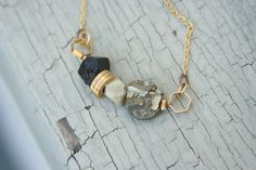 pyrite, black tourmaline, faceted jade, and hexagon and round brass findings on gold chain