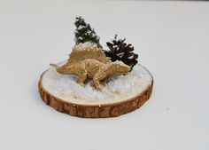 Glueing dinosaur and tree to woodslice for Christmas dinosaur terrarium Dinosaur Christmas Decorations, Christmas Trees For Kids, Christmas Hanukkah, Christmas Dinosaur, Xmas Decorations, Christmas Projects, Winter Christmas, Christmas Time, Christmas Ornaments