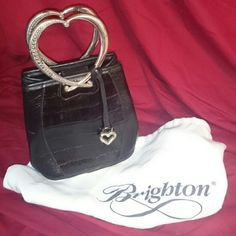 Small handbag  GENUINE BRIGHTON This beautiful genuine Brighton handbag stands 7 inches tall not including the handle the base of the bag is eight and a half inches wide the handle does show some wear but this handbag is still in really great condition if you'd like to see better pictures of the handle I will give you my phone number and we can text photos back and forth Brighton Bags Mini Bags