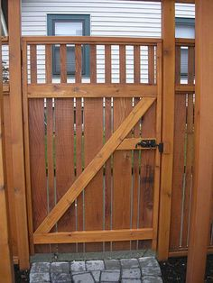 Out of all the cedar fence gate designs out there, this gorgeous, rustic wooden fence is the perfect touch as an entranceway to the garden! Fence gate ideas and design.