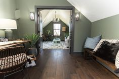 Masters of Flip luxe lodge green-walled flex space office with desk, chair and faux-fur throw pillows Masters Of Flip, Black And White Chair, White Chairs, Black White, House Flippers, Compact Table And Chairs, Farmhouse Table Chairs, Living Room Chairs, Desk Chairs