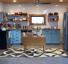floor to ceiling subway tile in the kitchen, those blue cabs, and that island!  swoon.