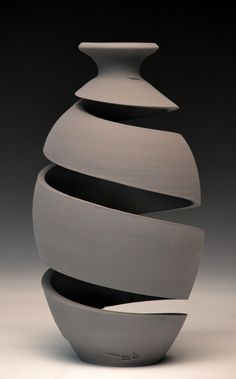 Michael Boroniec: Spatial Spirals, 2013 What began with teapots and a single spiral, has evolved into a series of vases that vary in form, degree of expansion, and number of coils. Each vessel is...