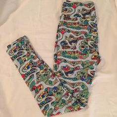 NWT LuLaRoe Busy Town Leggings, Hard to find! Buttery soft LuLaRoe leggings in one size. Busy Town road print. Hard to find unicorn. New with tags. Smoke free and pet free home. LuLaRoe Pants Leggings