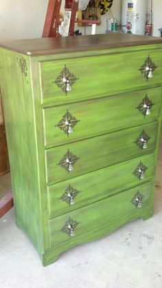 Green painted, refinished dresser. $10 garage sale find. The original hardware and old mistreated wood are long gone.
