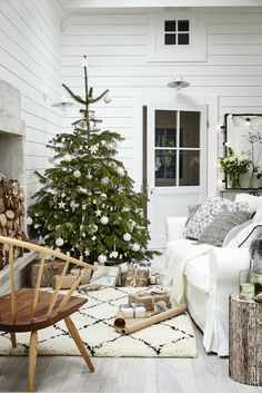 Add contrast to a neutral scheme with pared-back wood furniture and luxurious textures. A gorgeous House Beautiful bouquet provides a delicate finishing touch. For more Christmas inspiration visit housebeautiful.co.uk