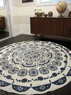 Wa·lah!!! It's a DIY Tablecloth Turned into Rug This idea is genius! Using a cool patterned tablecloth, make a rug with the help of a pair of scissors and basic supplies like fabric glue.