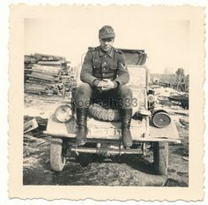 A personal photo of a soldier and his Kubelwagen