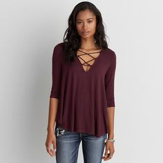 AEO Soft Sexy Lace-Up Top ($22) ❤ liked on Polyvore featuring tops, maroon lagoon, lace front top, lace up front top, american eagle outfitters, laced tops and sexy tops