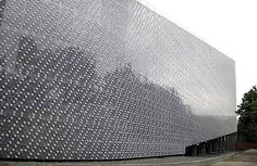 huge building covered with empty plastic bottles
