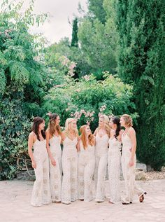 Fabulous jumpsuits! The Ultimate Boho Chic Beach Wedding - http://www.stylemepretty.com/destination-weddings/spain-weddings/2016/05/17/green-white-gold-beach-wedding-with-gorgeous-succulent-bouquet/