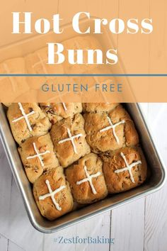 These Gluten Free Hot Cross Buns are delicious buns that will melt in your mouth! No one will believe they're gluten free! They're sweetened with a hint of brown sugar and chock full of plump raisins and dried cranberries... Plus they double as a beautiful table decoration for Easter! #zestforbaking #glutenfreerecipes #hotcrossbuns #glutenfreeEaster