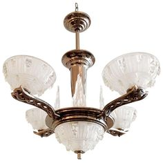 View this item and discover similar for sale at - A great French Art Deco four light chandelier with clear/frosted glass shades and icecycle glass decorations. It has a polished nickel fixture. Art Deco Chandelier, Art Deco Lighting, Chandelier Pendant Lights, Modern Chandelier, Vintage Lighting, Chandeliers, Art Nouveau, Art Deco Jewelry, French Art