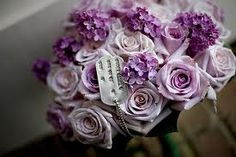 I have not always been a purple fan but I did a purple wedding this summer and I fell in love with lavender roses