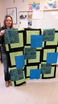 Thanks, Jenny, for holding my crayon quilt top so I could get a good picture.  :)