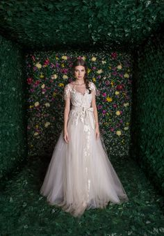 http://www.rheacosta-shop.com/details/tulle-and-lace-princess-gown-with-detachable-cape-17005d
