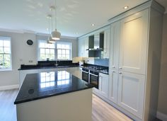 Partridge Grey units with Black granite worktops, up-stands and window sills. Designed, Supplied and Installed by Kitchencraft!