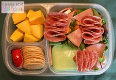 Mommy's lunch: simple salad with peas, carrots, mixed greens, ham, and skewers of salami. Also, rice crackers and Baybel cheese,  and mango chunks.