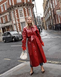 51 street style looks set to transform your summer wardrobe. See (and shop) the best outfits we've discovered. Rain Fashion, Spring Fashion, Cool Outfits, Casual Outfits, Fashion Outfits, Red Raincoat, Plastic Pants, Bronze, Next Clothes
