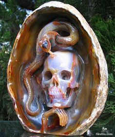 Knowledge Begat Wisdom plays with the symbolism of the serpent, representing knowledge and wisdom, and the posture of contemplation displayed by the crystal skull. When one has knowledge one does not automatically achieve wisdom as well. Skull Artwork, We Will Rock You, Crystal Skull, Rocks And Gems, Skull And Bones, Stone Carving, Looks Cool, Rocks And Minerals, Sugar Skull