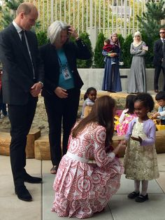 theroyalweekly:  Kensington Palace on Twitter: The Duchess receives a bouquet and a smile from one of the children in the playground @issbc in Vancouver #RoyalVisitCanada https:/t.co/LURnYF8LMv