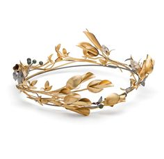 """The phrase """"blasted heath"""" used to describe the windswept trees along the coastline of Cornwall inspired this Mirri Damer crown, set with tiny shells and Serpentine - a Cornish semi-precious stone."""