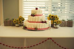 Diaper cake for the gift table.    #babyshowerideas #diapercakes http://www.nashvillewrapscommunity.com/blog/2009/10/diaper-cakes-how-to-make-this-must-have-gift/