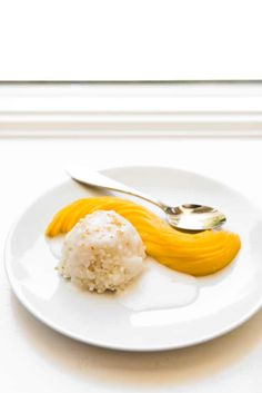 Thai Coconut Mango Sticky Rice is made with sweet, yellow mango, sticky rice, and an amazing coconut sauce that will transport you right to the tropics! Coconut Sticky Rice, Mango Sticky Rice, Coconut Sauce, Thai Coconut, Rice Maker, Thai Dessert, Thai Restaurant, Grubs, Thai Recipes