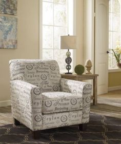 Alenya Accent Chair The sleek mid-century lines of the Alenya Accent chair are always in vogue. With a neatly tailored box cushion and padded arms, the script-patterned chair is supremely comfortable and stylish. Linen blend upholstery and piping further refine the silhouette.