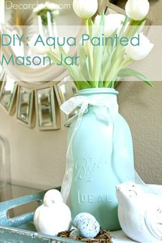 I love the color and the idea of using a mason jar.  I've also spray painted lotion, q-tip, and cotton ball jars and loved the results.